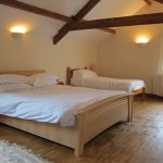Coach House bedroom with double and single bed